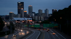 The Pittsburgh skyline and I-279 at night, in Pittsburgh, Pennsylvania. - stock footage
