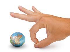 Hand ready attack at model of globe Stock Photos