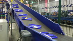 Parcels traveling on the conveyor belt - stock footage