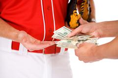 Baseball: Players Exchanging Money In Bet Or Bribe - stock photo