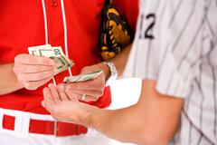 Baseball: Players Exchanging Money In Bet Or Bribe Stock Photos