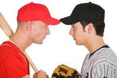 Baseball: Players From Opposing Teams Stand Eye to Eye - stock photo