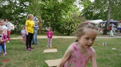Girl Run Play Around The Paper On The Grass Stock Footage