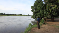 Journalist Looks out at the Blue Nile River, Juba, SOUTH SUDAN Stock Footage
