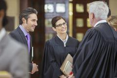 Judges and lawyers talking outside courtroom Stock Photos