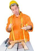 Carpenter working on an circular saw Stock Photos
