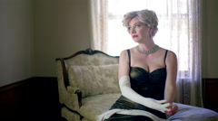 Fifties style blonde takes off white opera glove 4K - stock footage