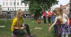 Children Play A Game To Cast The Chips In Iron Jar Stock Footage