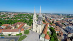 Aerial view of Zagreb's cathedral, with cityscape in background. Stock Footage