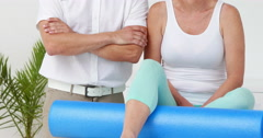 Physiotherapist and patient smiling at camera Stock Footage