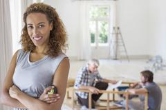 Woman smiling in living space in family working - stock photo