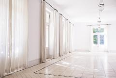 Sunlight streaming through windows of living space Stock Photos