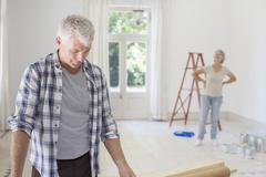 Older couple observing new living space Stock Photos