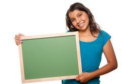 Pretty Hispanic Girl Holding Blank Chalkboard Isolated on a White Background. - stock photo