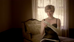 Fifties style woman takes off white opera glove 4K - stock footage