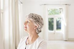 Older woman overlooking living space - stock photo