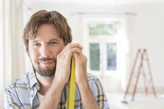 Man smiling in living space Stock Photos