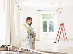 Man overlooking living space near construction materials - stock photo