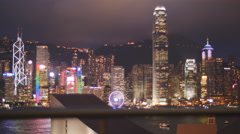 Light display at Hong Kong harbour from roof top 4K Stock Footage