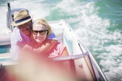 Couple sitting in boat together - stock photo