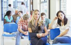 Women sitting in hospital waiting room Kuvituskuvat