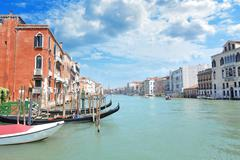 Grand Canal in Venice, lined by lavish Venetian buildings - stock photo