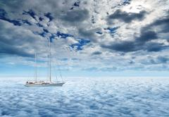 Sailing yacht on a peaceful ocean voyage to paradise Stock Photos