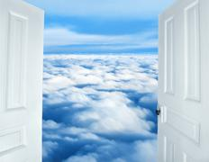 Doors opening to a heavenly sight of fluffy clouds Stock Photos