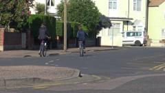 Stock Video Footage of Two Boys or Children Cycle Up a Quiet Road
