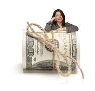Hispanic Woman Leaning on a Roll Of Hundred Dollar Bills - stock photo