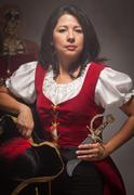 Dramatic Female Pirate in a Dimly Lit Moody Scene. - stock photo