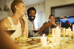 Friends talking at dinner party Stock Photos