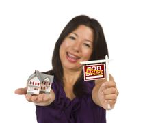 Multiethnic Woman Holding Small Sold For Sale Real Estate Sign and House Stock Photos