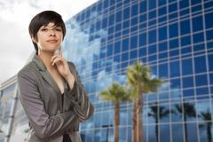 Attractive Mixed Race Young Adult in Front of Corporate Building. - stock photo