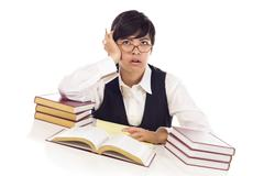 Bored Mixed Race Female Student at Desk with Books - stock photo