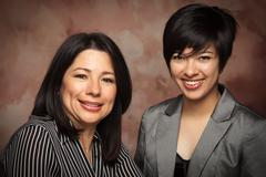 Attractive Multiethnic Mother and Daughter Studio Portrait - stock photo