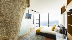 Rock feature in modern bedroom Stock Photos