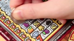 Scratching lottery ticket - stock footage