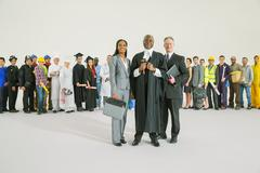 Workforce behind confident judge and lawyers Stock Photos