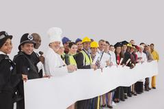 Portrait of diverse workforce with blank signs - stock photo