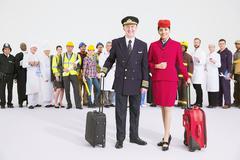 Portrait of confident pilot and flight attendant - stock photo