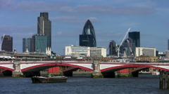 Blackfriars Bridge with the city office tower blocks in London Stock Footage