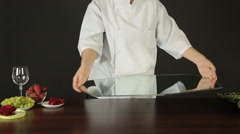 Female Cook Putting Tray on Table Stock Footage