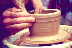 The potter molds a jug on the circle Stock Photos