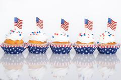 Stock Photo of Patriotic cupcakes with sprinkles and American flags