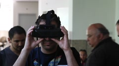 A man plays virtual augmented reality game using head mounted display - stock footage