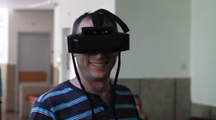 Stock Video Footage of A man plays virtual augmented reality game using head mounted display