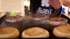 Cooking burger - roast meat cutlet at food fest Stock Footage