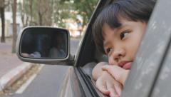 Sadness Asian girl looking out from car window - stock footage
