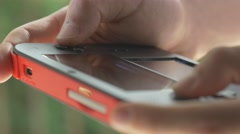 4K Playing Portable Gaming Device Outdoor Stock Footage